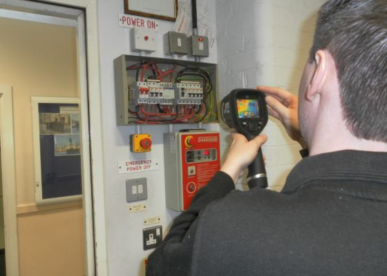 DSA Electrical Engineer using thermal imaging camera on fuse board